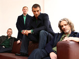 Wet Wet Wet keyboardist Neil Mitchell admits to assaulting his girlfriend in South-West London.