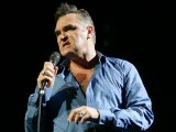 "Morrissey says that Damien Hirst's head should be ""kept in a bag"" for using dead animals in his work."