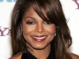 Janet Jackson appears at the London premiere of Why Did I Get Married Too? with cropped hair.