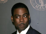 Comic Chris Rock dismisses speculation that he has a lovechild with another woman.
