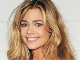 Denise Richards showing off her new dress by 'Pink Polka dot' while on-set filming 'The Denise Richards Reality Show' in Malibu, California, America