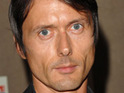 Suede frontman Brett Anderson admits that he is amused by his fake Twitter account.