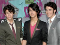 The Jonas Brothers are reportedly trapped in an elevator for almost an hour.