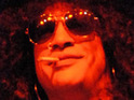Ronnie Wood claims that he gave Slash guitar tips when the Gun N' Roses guitarist was growing up.