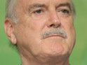 John Cleese is wheeled on to The Graham Norton Show due to a serious knee problem.