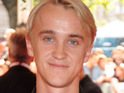 Tom Felton says he was once praised for his performance in the Harry Potter films by J.K. Rowling.