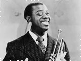 Louis Armstrong holding his trumpet