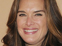 Brooke Shields admits that a lioness once bit her bottom during filming for Running Wild.