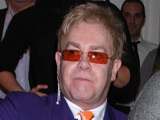 Elton John and Sam Taylor-Wood at the auction of 'Champions' photographic portraits to benefit 'The Elton John AIDS Foundation'
