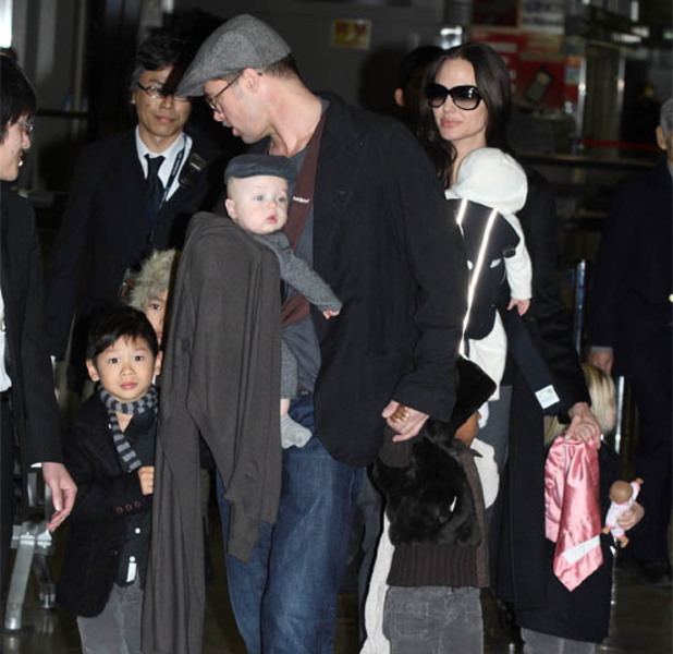 Brad Pitt and Angelina Jolie with family arriving at Narita International airport, Chiba, Japan