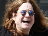 Ozzy Osbourne greets the waiting paparazzi in Beverley Hills