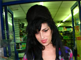 Amy Winehouse looking well as she visits a shop after leaving her new home, Barnet