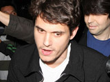 John Mayer is surrounded by photographers as he leaves Katsuya restaurant Los Angeles.