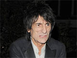 Ronnie Wood arrives back at his home, just after 2am appearing rather worse for wear, following a night out with his girlfriend, London