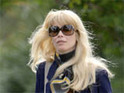 Claudia Schiffer is criticized for controversial photographs of her wearing black face make-up.