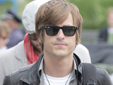 Jared Followill of Kings of Leon boarding at LAX after their 2009 MTV Movie Awards gig