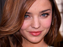 Miranda Kerr becomes the first supermodel to appear in a 3D photoshoot for Vogue magazine.