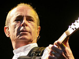 Francis Rossi of Status Quo performing in concert at Aintree Racecourse. Liverpool, England.