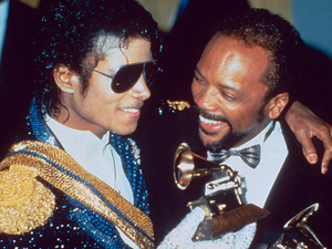 Jacko and Quincy Jones with their Grammy Awards for 'Thriller', one of eight awards the star won in 1984