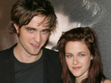Robert Pattinson and Kristen Stewart deny having a 'massive' row while on the set of Eclipse.