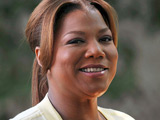 Queen Latifah eating pineapple on the set of 'Just Wright' in Brooklyn, New York