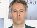 Adam Yauch says that, despite a number of reports, he is not yet completely free of cancer.