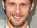 True Blood star Alexander Skarsgard is restrained by police at a California music festival.