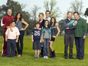 ABC defends Modern Family after fans complain that the show's gay couple do not kiss each other.