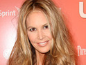 Elle Macpherson admits that when cameras are around, she naturally acts like a model.