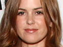 Isla Fisher reveals that she hid her pregnancy during the filming of her latest movie.