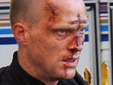 Paul Bettany with a bloody face and cross drawn on his forehead on the film set of 'Priest', Los Angeles