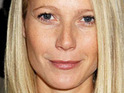 Gwyneth Paltrow claims that she is happy despite how she is portrayed by the paparazzi.
