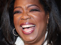 Thousands of Australian fans queue to see Oprah Winfrey at the Sydney Opera House.