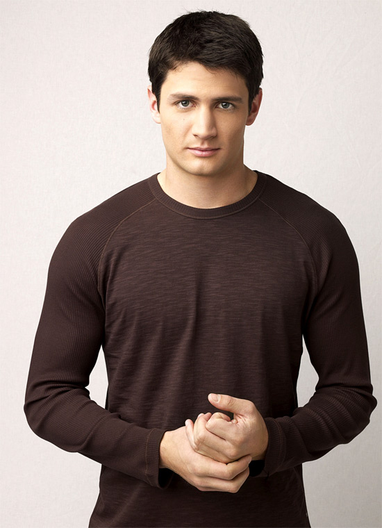 James Lafferty in brown top