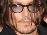 Johnny Depp leaving his hotel followed by fans, New York City