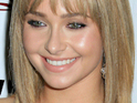 Hayden Panettiere dismisses rumors of Scream 4 set problems and says that she loves her role.
