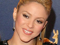 Shakira scraps her raunchy video plans so that Dizzee Rascal can feature in it, reports say.