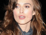 Keira Knightley signs autographs for fans as she leaves the Comedy Theatre. London, England.