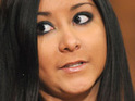 The boyfriend of Jersey Shore cast member Nicole 'Snooki' Polizzi claims that the pair are in love.