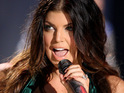 Fergie admits that she is too focused on her career with the Black Eyed Peas to have children.