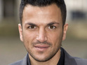"Peter Andre says that he has to hold back the release of a collaboration with two ""mega"" US acts."