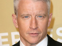 CNN journalist Anderson Cooper claims that Lady GaGa made him drink whiskey during a recent interview.