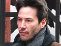 Keanu Reeves jokes about those who criticize him for his apparent lack of smiling.