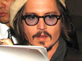 Johnny Depp signs autographs for fans outside Hot Topic after attending 'Alice In Wonderland' Great Big Ultimate Fan Event Los Angeles, California.