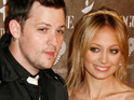 Nicole Richie weds long-term boyfriend Joel Madden in a ceremony at Lionel Richie's mansion.