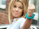 Kerry Katona in high spirits as she leaves her mums house. Warrington - England.