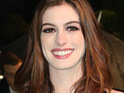 Anne Hathaway admits that she often guards her emotions when beginning romantic relationships.