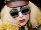 Lady GaGa leaving her London hotel in a considerably dressed-down military-esque outfit