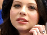 Michelle Trachtenberg and guest at the Detroit Pistons vs New York Knicks game, NYC