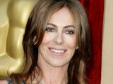 Director Kathryn Bigelow gleaming for the photographers as she walks the Oscars red carpet